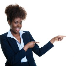 63534593 - african american business woman pointing sideways on an isolated white background for cut out